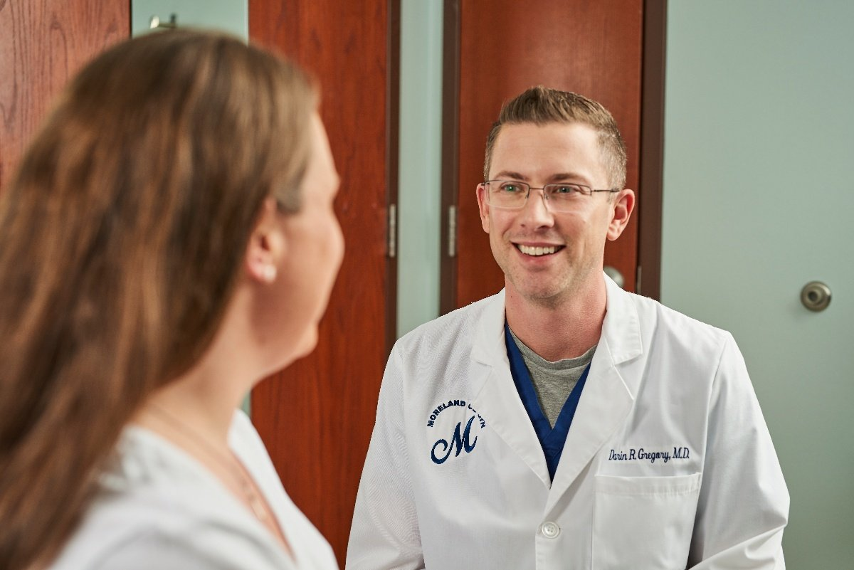 Moreland OB-GYN doctor, Dr. Gregory, with a patient in Watertown.